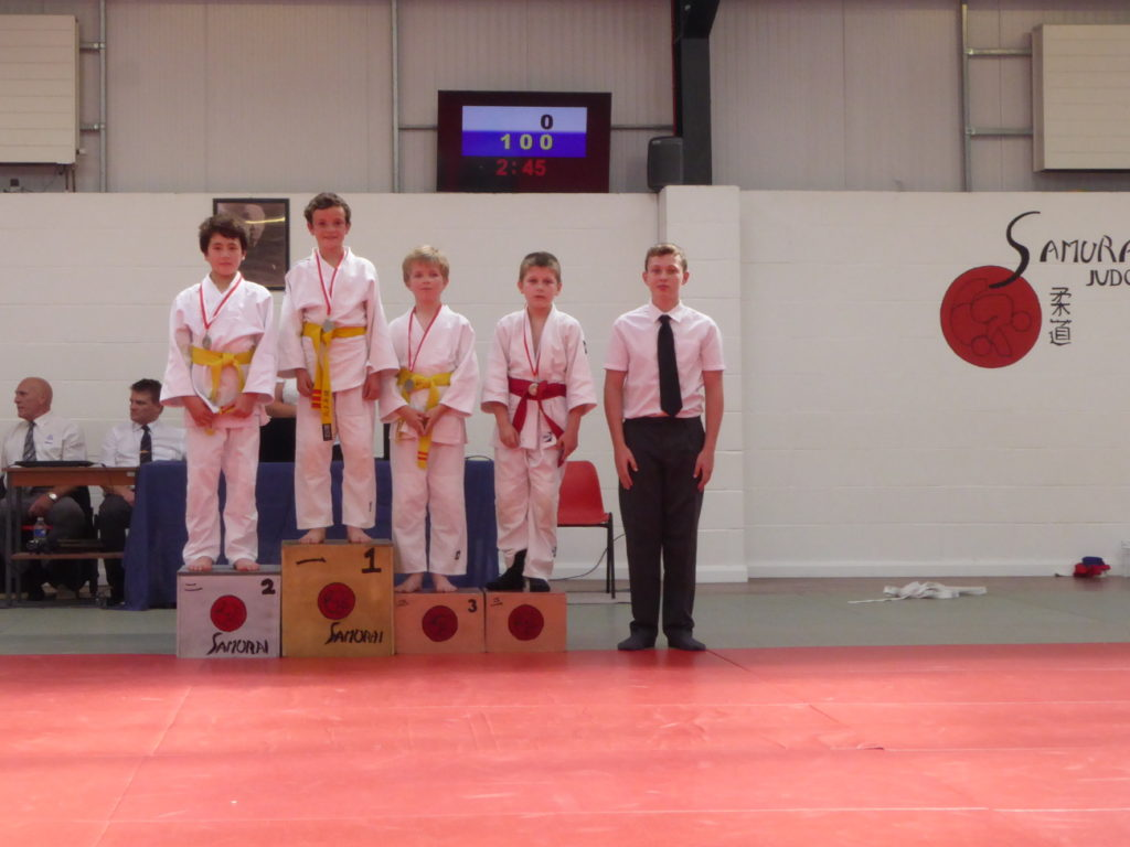 Kai getting a silver medal at the Samurai Green and Under competition